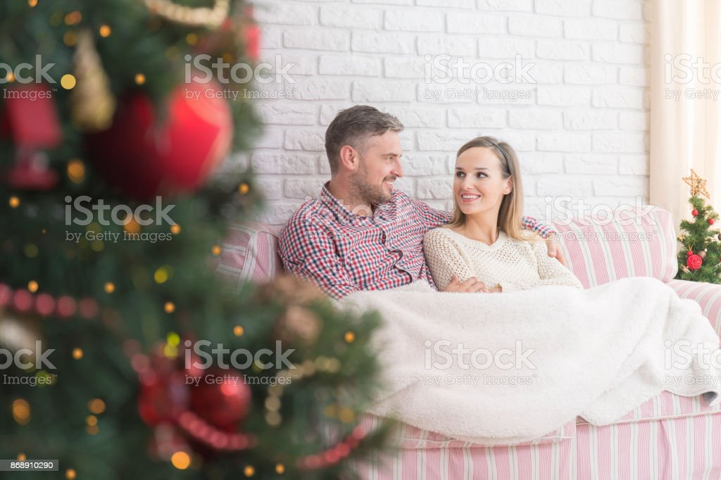 Young marriage on the couch stock photo