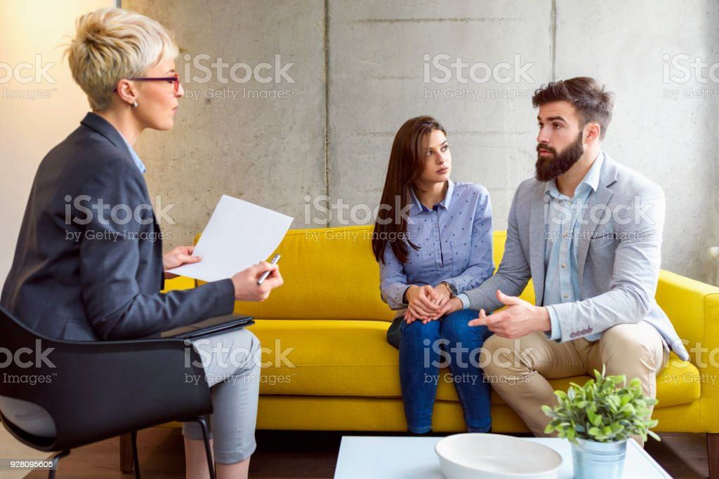Young married couple at their counselor stock photo