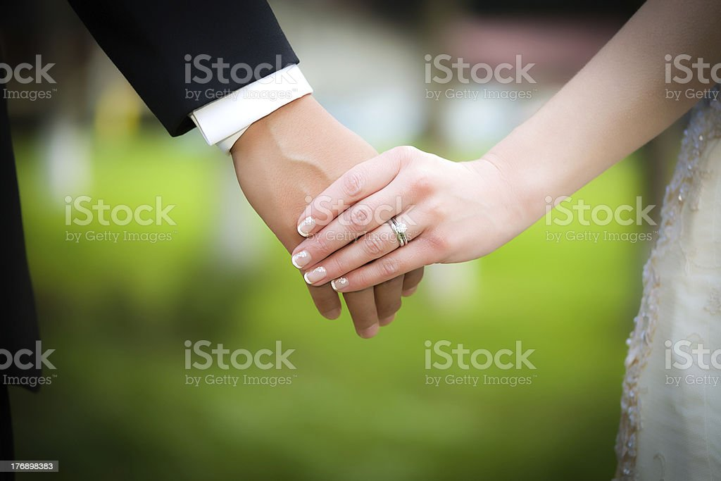 Young married couple holding hands stock photo
