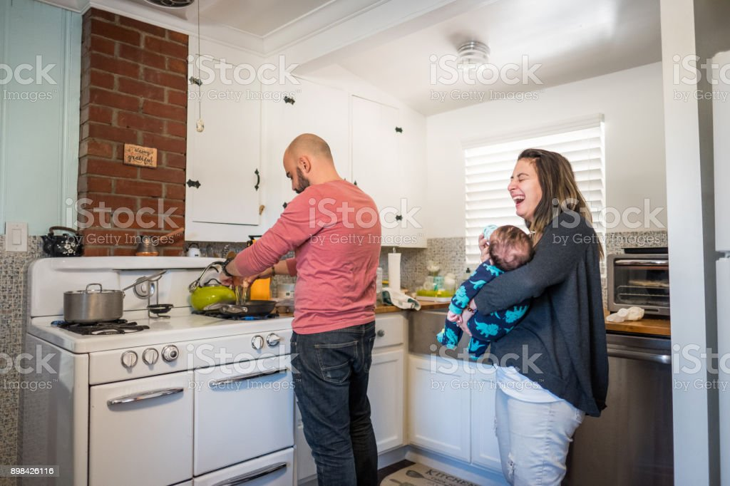 Young married couple making breakfast stock photo