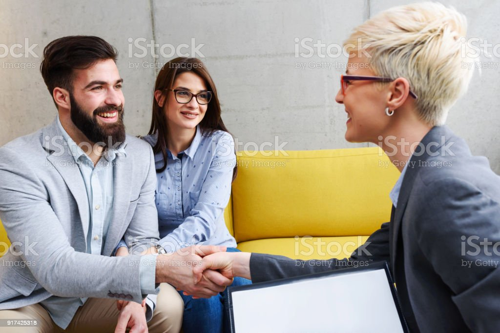 Young married couple with real estate agent stock photo