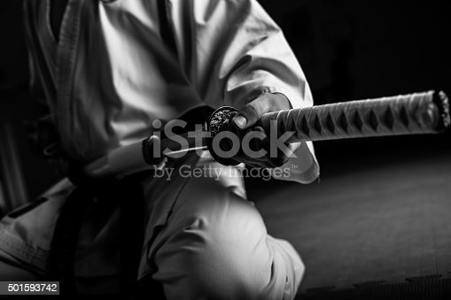 istock Young martial arts fighter with katana 501593742