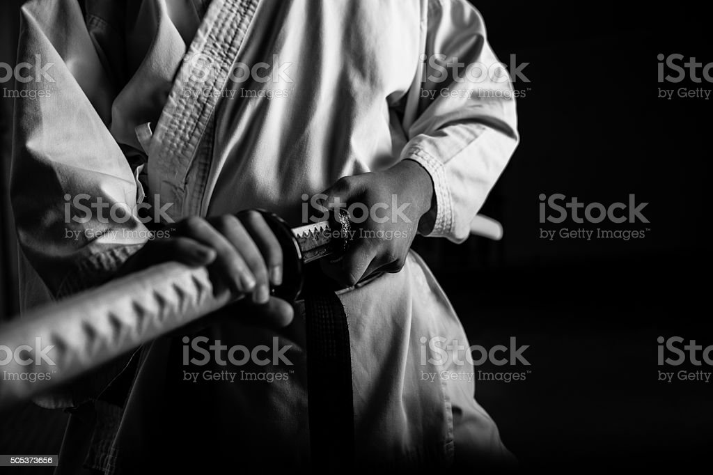 Young martial arts fighter with katana stock photo