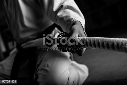 istock Young martial arts fighter with katana 507554424