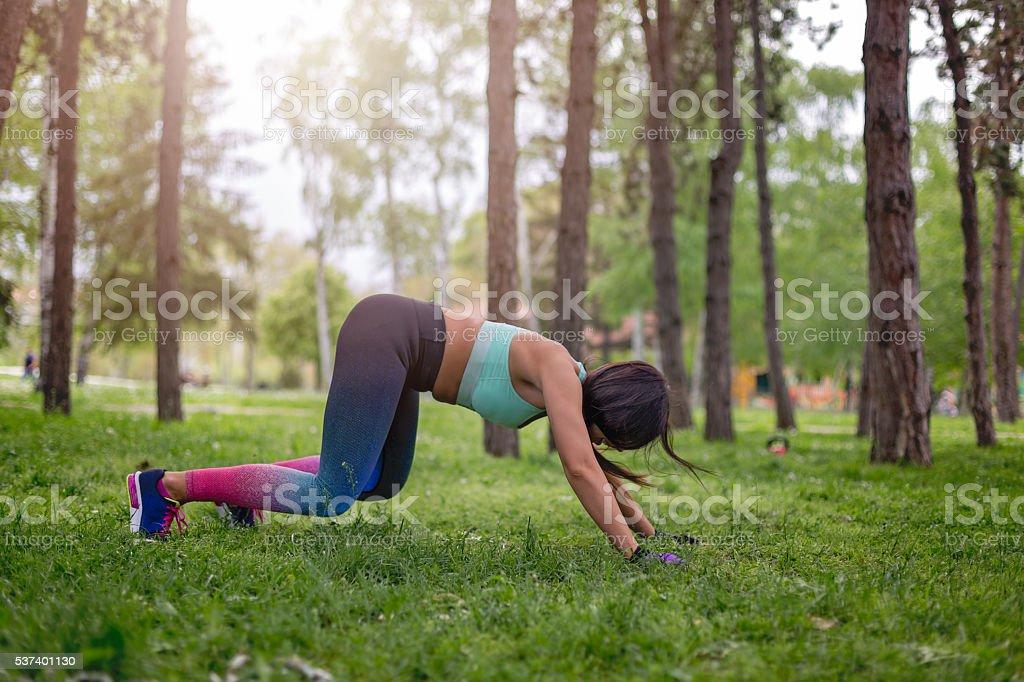 young masculine woman doing push ups stock photo