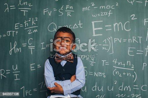 143176157 istock photo Young Math Nerd Boy in Classroom 940337108