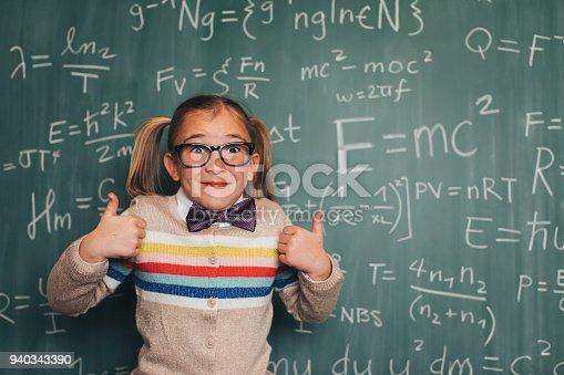 143176157 istock photo Young Math Nerd Girl in Classroom 940343390