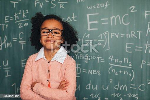 143176157 istock photo Young Math Nerd Girl in Classroom 940355282