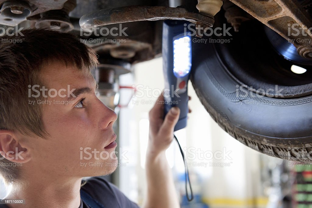 young mechanic at work in auto repair shop royalty-free stock photo
