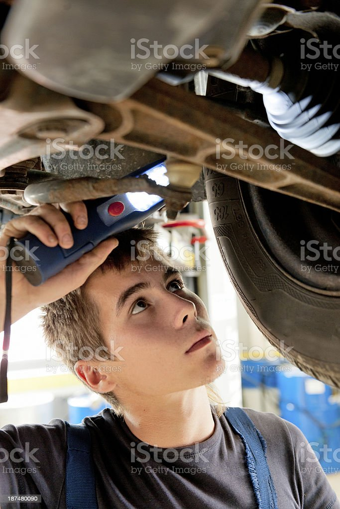 young mechanic at work in auto repair shop stock photo