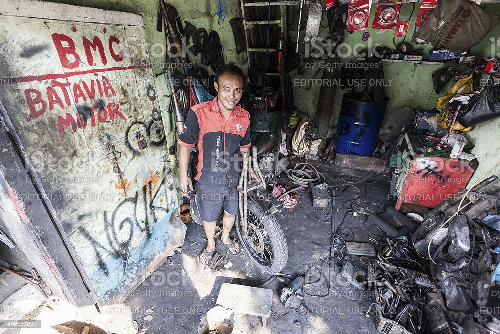 Young Mechanic in His Workshop, Jakarta, Indonesia royalty-free stock photo