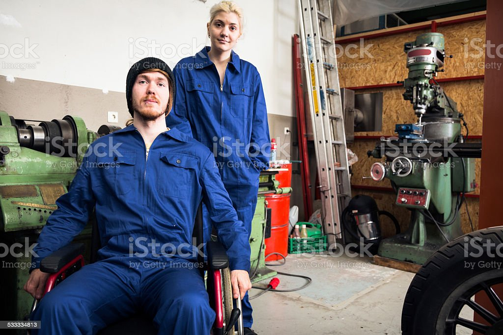 young mechanics / apprentices in a workshop stock photo