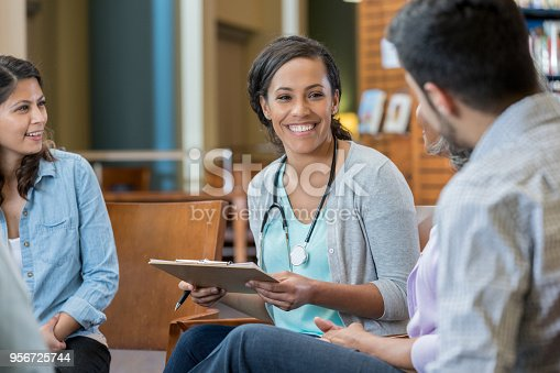 istock Young medical instructor sits in a circle with students 956725744