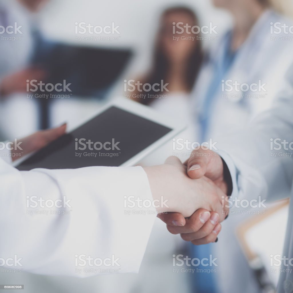 Young medical people handshaking at office royalty-free stock photo