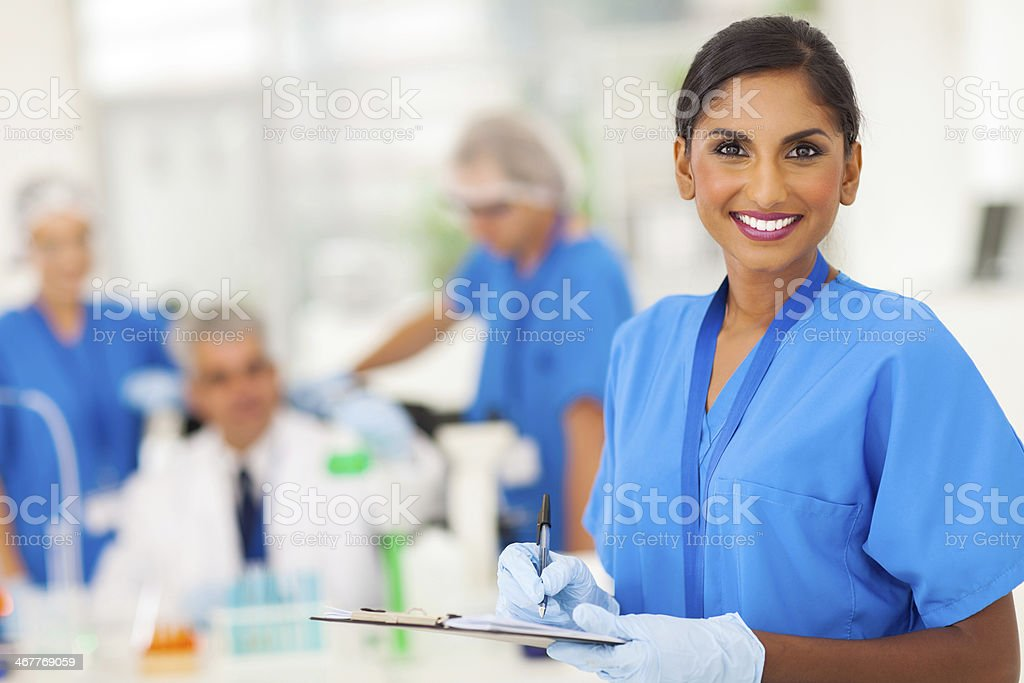 young medical researcher writing report stock photo