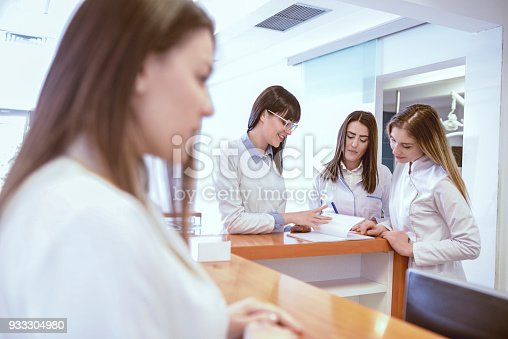 istock Young Medical Team Have Small Meeting at Clinics Reception 933304980