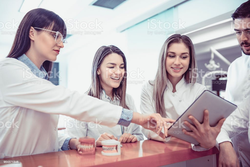 Young Medical Team Have Small Meeting at Clinics Reception stock photo