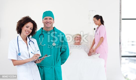 istock Young medical team standing near a patient 856010254
