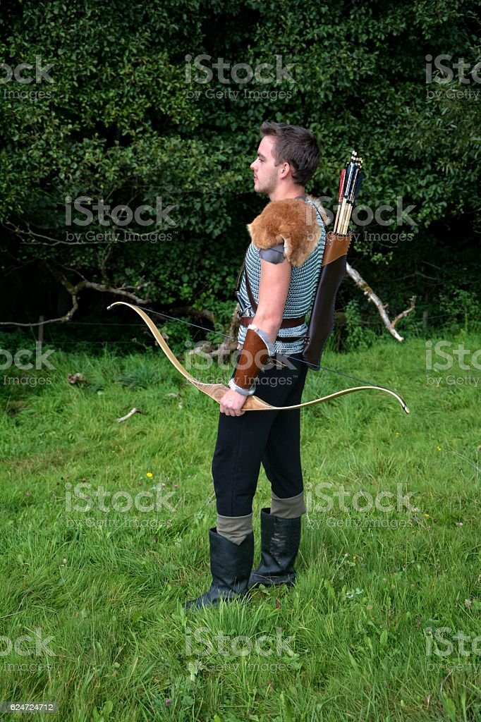 Young medieval archer with chain shirt, bow and arrow i stock photo