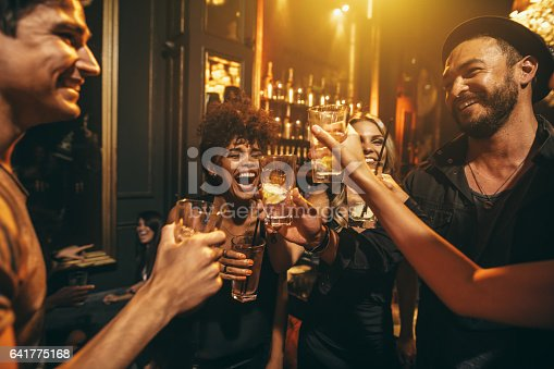 istock Young men and women enjoying a party 641775168