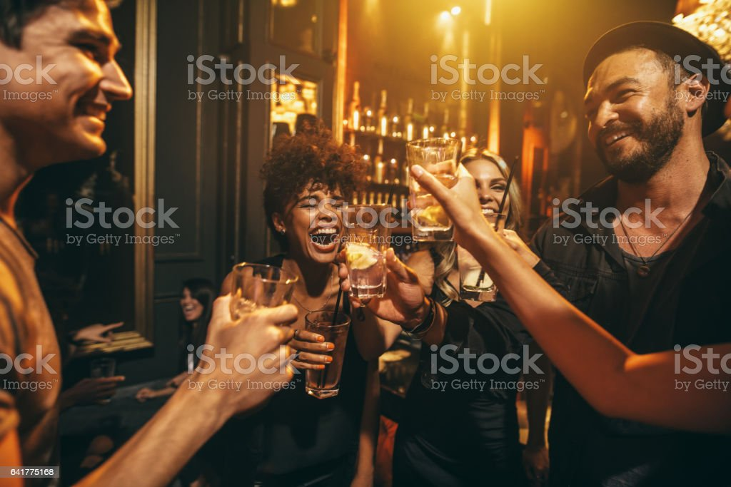 Young men and women enjoying a party stock photo