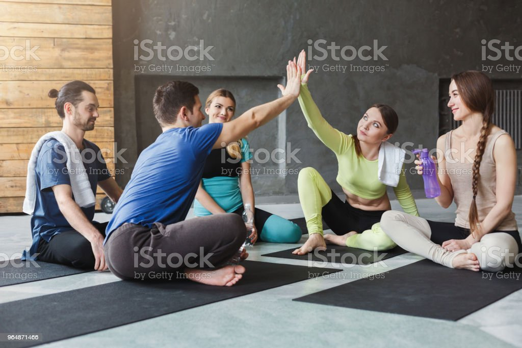 Young men and women in circle with united hands. royalty-free stock photo