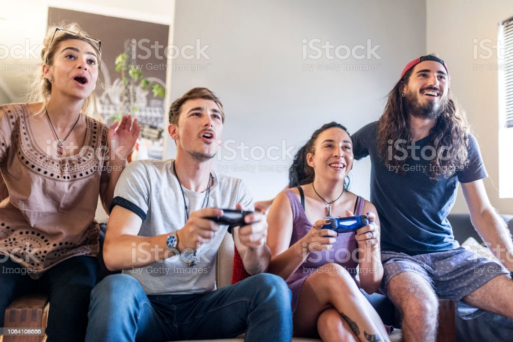 Young Men And Women Playing Video Game At Home Stock Image