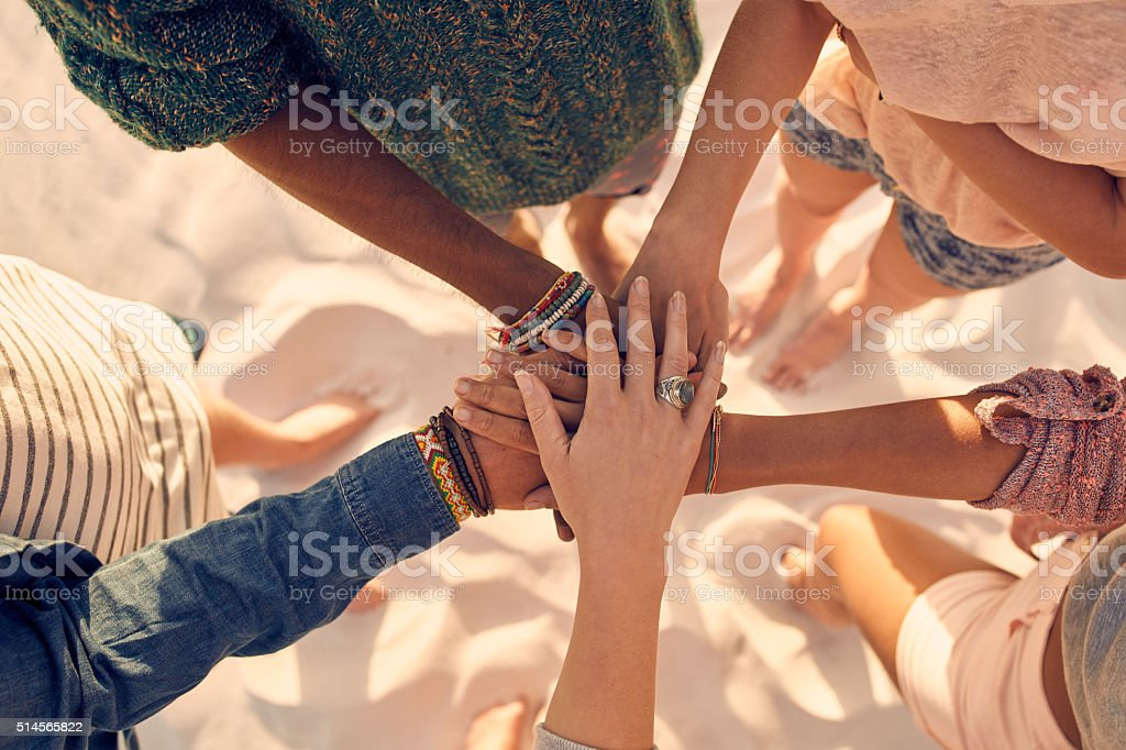 Young men and women showing unity stock photo