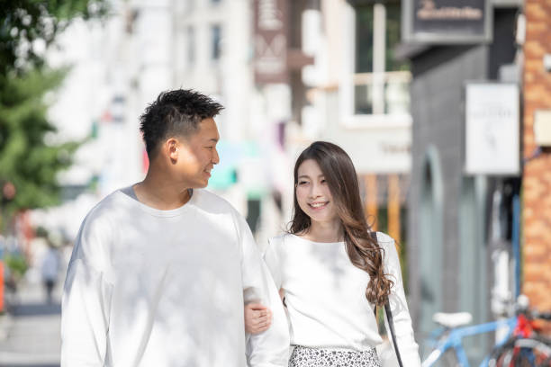 Young men and women who get along in town stock photo