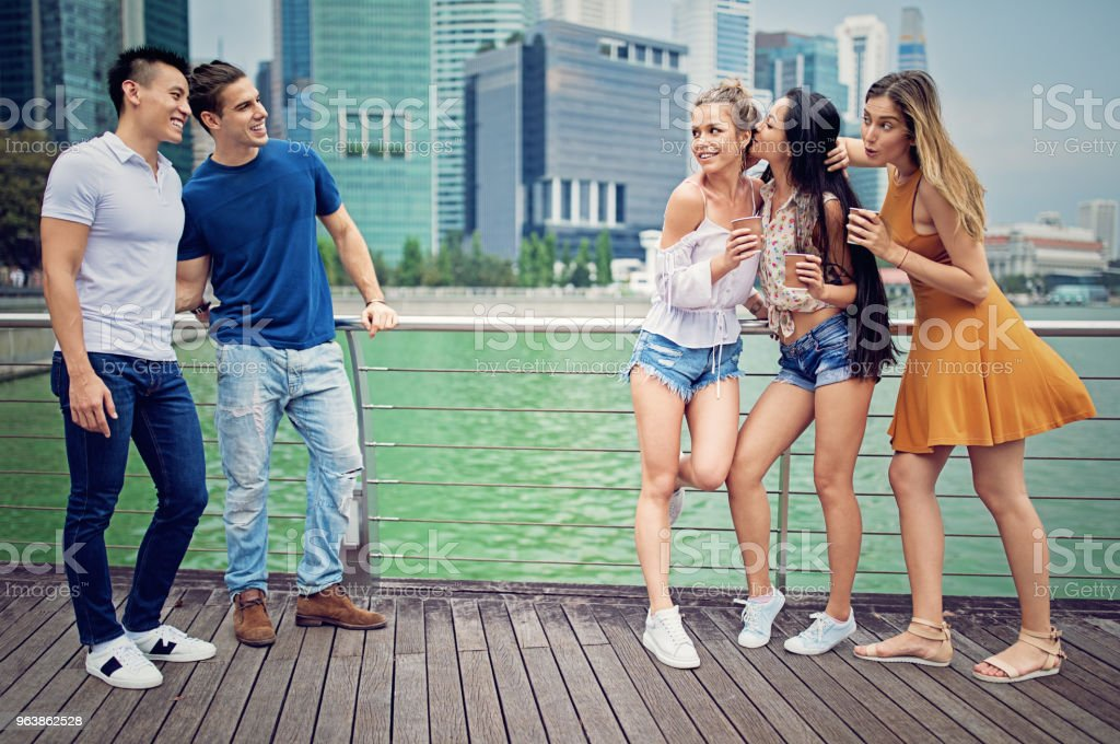 Young men are attracted and flirting with a girls - Royalty-free Adult Stock Photo