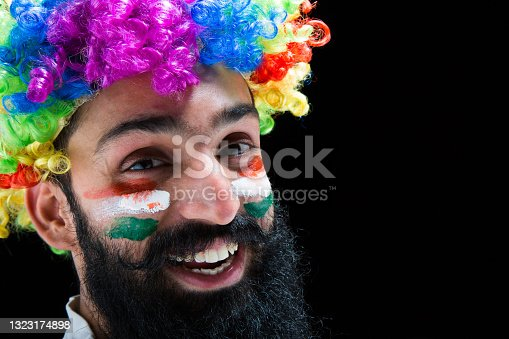 istock young men biggest fan of a cricket game:- stock photo 1323174898