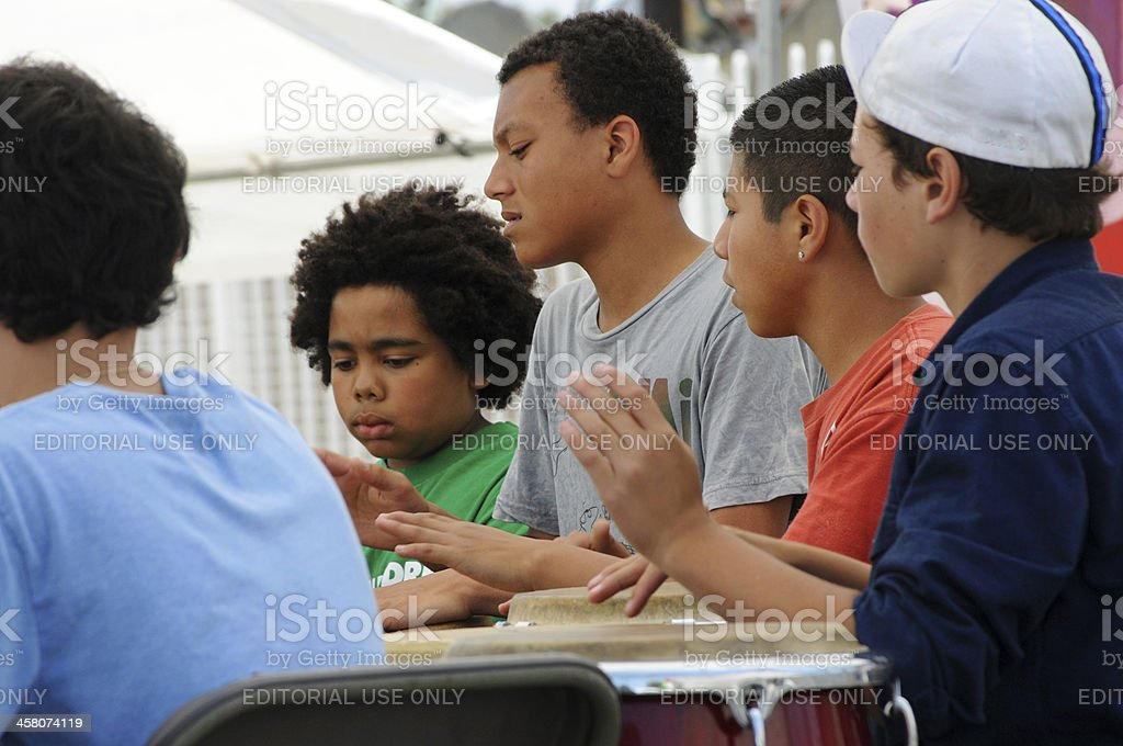 Young men drumming at Los Angeles community festival stock photo