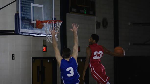young men dunking a basketball in a gymnasium - balpress bildbanksfoton och bilder