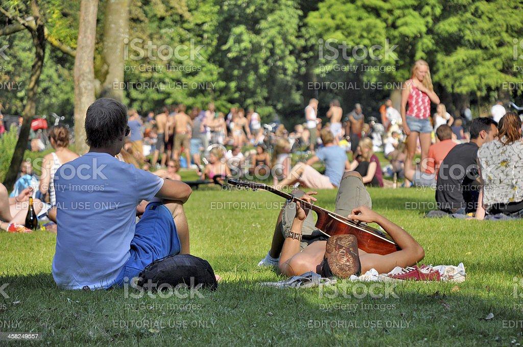 Young men enjoying summer at Vondelpark in Amsterdam stock photo