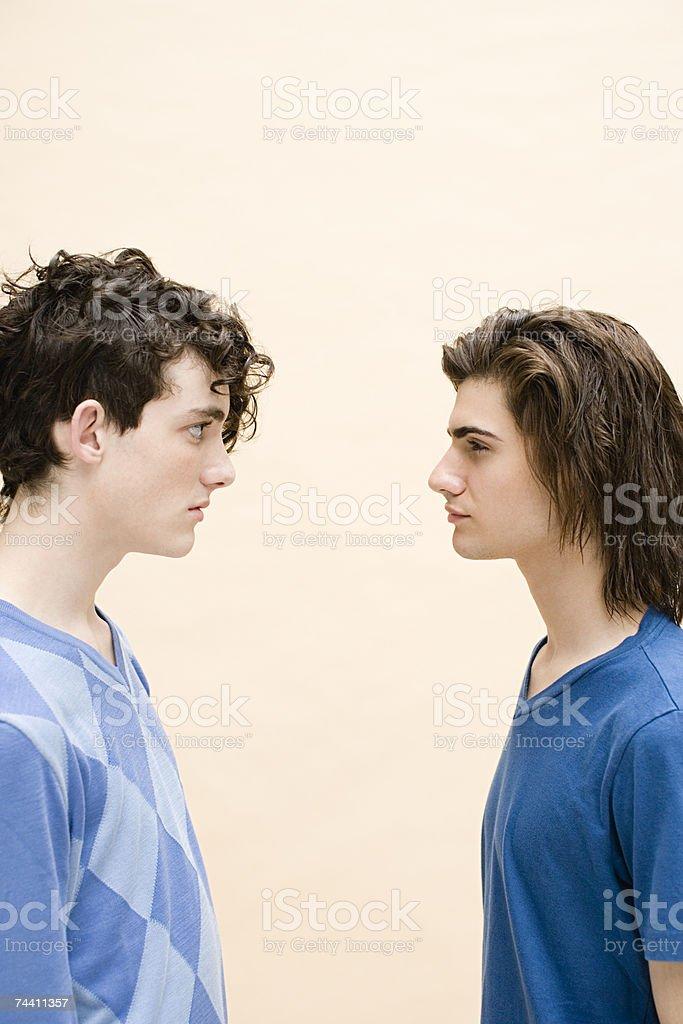 Young men face to face stock photo