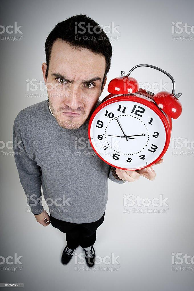 Young men holding alarm clock royalty-free stock photo