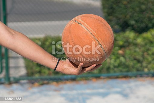 Young men holding basketball
