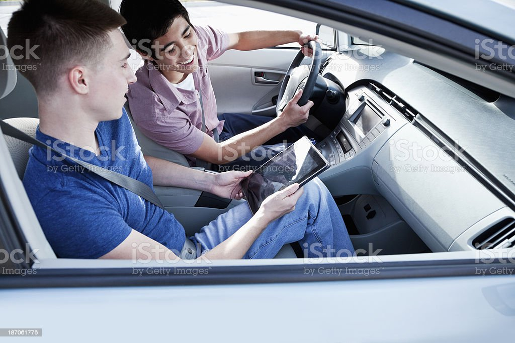 Young men in car stock photo