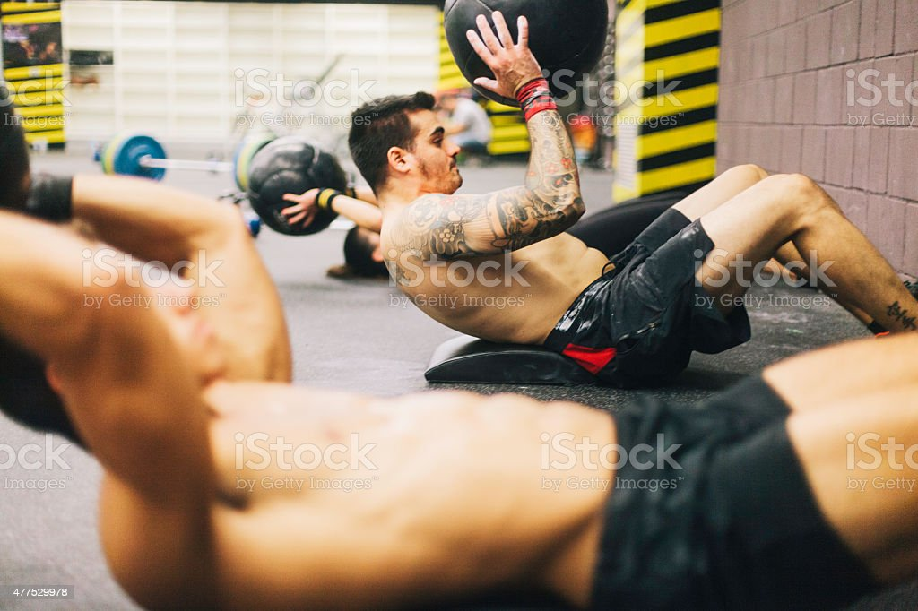 Young men in high intensity fitness session. stock photo