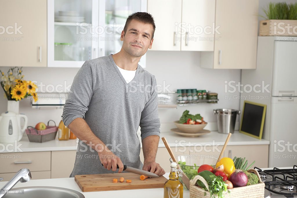 Young men in kitchen. royalty-free stock photo