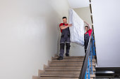 istock Young Men In Uniform Carrying Mattress Downward 1180605630