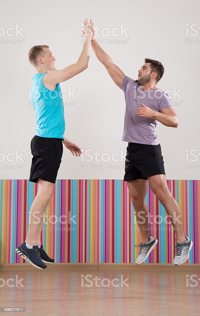 Young men jumping stock photo