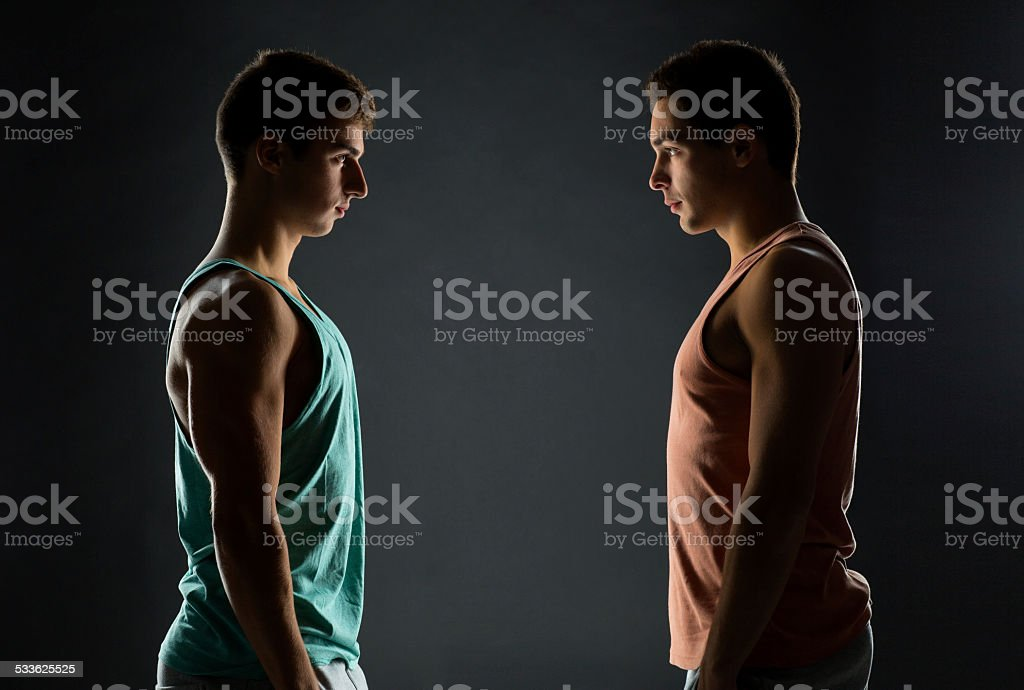 young men looking to each other stock photo
