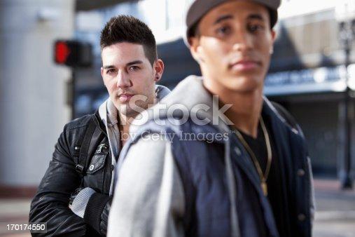 521022435 istock photo Young men on city street 170174550