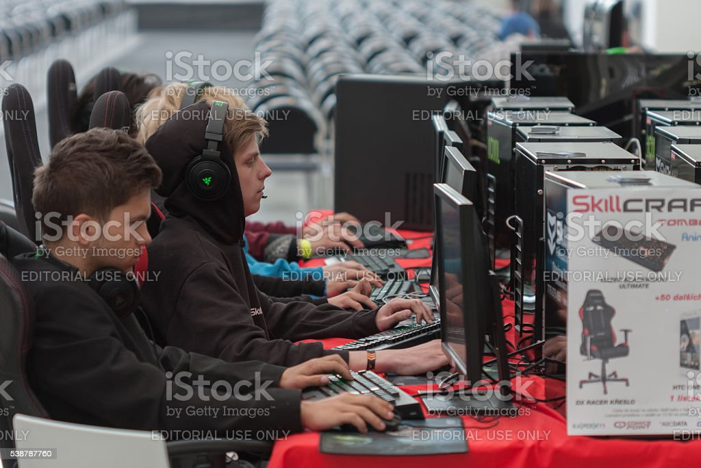 Young men play game on PC  at Animefest stock photo