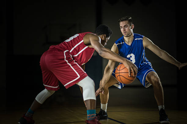 young men playing basketball in a gymnasium - balpress bildbanksfoton och bilder