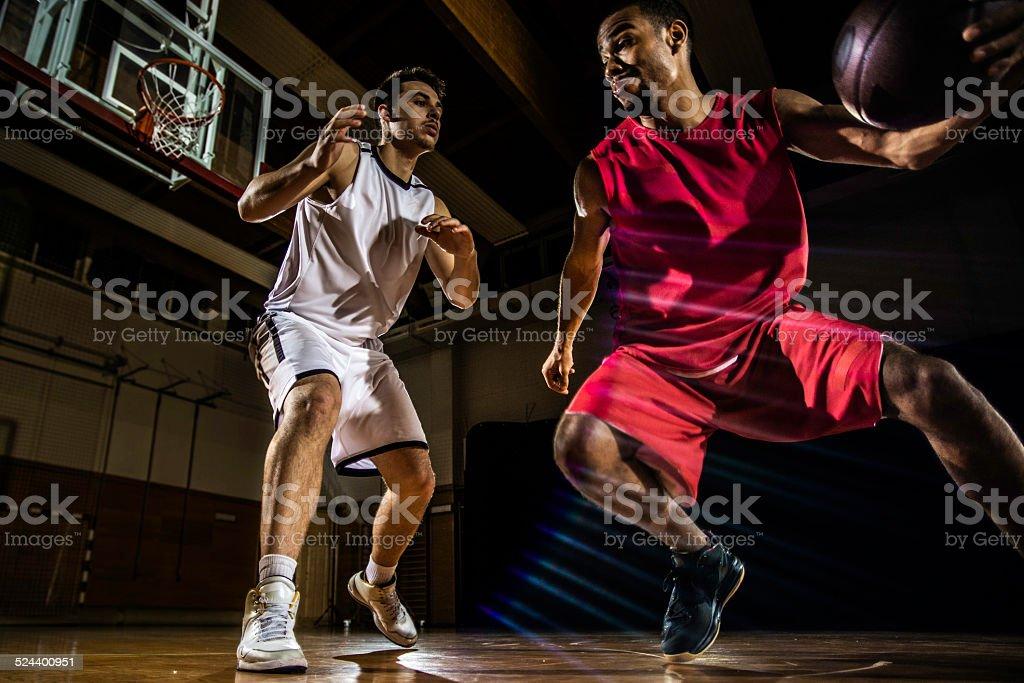 Young Men Playing Basketball stock photo