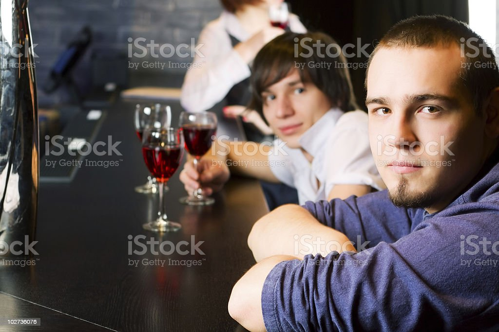 Young men relaxing in a night bar royalty-free stock photo