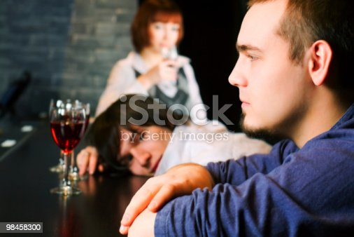 Young Men Relaxing In A Night Bar Stock Photo & More Pictures of Adult