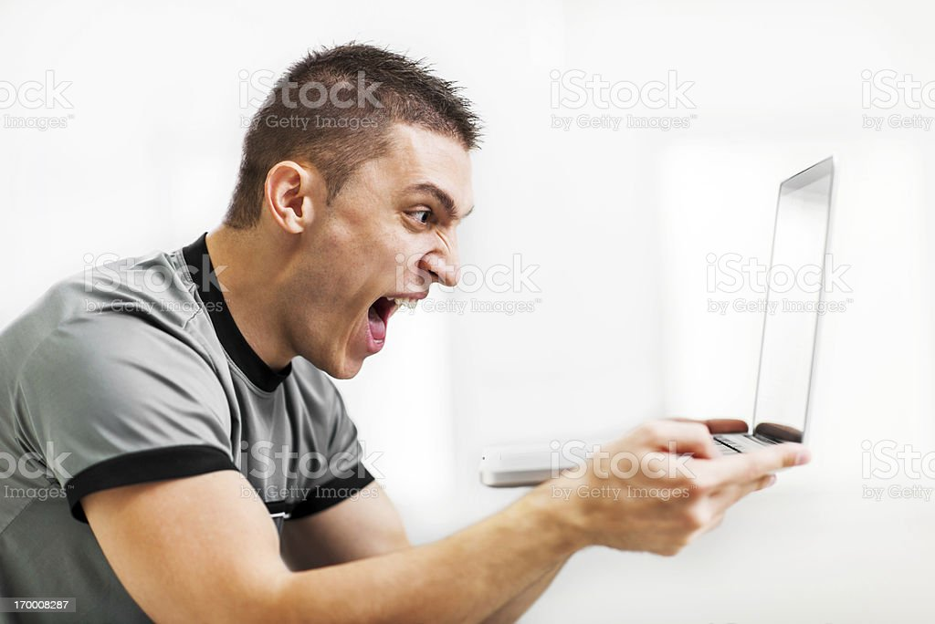 Young men screaming and holding laptop. royalty-free stock photo